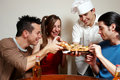 Cheerful group of youth in a pizza Royalty Free Stock Images
