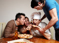 Cheerful group of youth in a pizza Stock Image