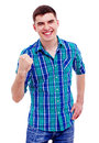 Cheerful guy with raised fist happy young man in checkered shirt isolated on white background mask included Royalty Free Stock Photo