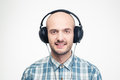 Cheerful handsome young man listening to music in headphones Royalty Free Stock Photo