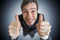 Cheerful and happy man is showing thumbs up gesture Royalty Free Stock Photo