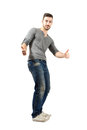 Cheerful happy young male showing thumbs up full body length isolated over white background Royalty Free Stock Images