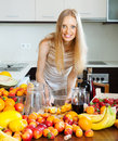 Cheerful housewife making cocktail alcoholic with fruits Royalty Free Stock Image