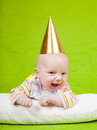 The cheerful kid in a celebratory cap Royalty Free Stock Image