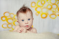 Cheerful little baby girl with downs syndrome Stock Photos