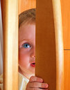 Cheerful little baby playing hide seek Royalty Free Stock Photography