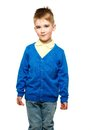 Cheerful little boy in blue cardigan and yellow shirt Stock Image