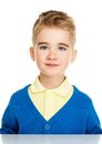 Cheerful little boy in blue cardigan and yellow shirt Stock Images