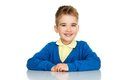 Cheerful little boy in blue cardigan and yellow shirt Royalty Free Stock Image