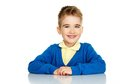 Cheerful little boy in blue cardigan and yellow shirt Royalty Free Stock Photo