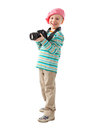 Cheerful little boy photographer holds camera wears beret red scarf striped sweater beige pants Stock Image