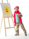 Cheerful little boy standing easel young artist holds his hands palette paints paints sun Stock Photos