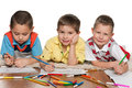 Cheerful little boys lying floor drawing paper Royalty Free Stock Image