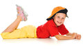 A cheerful little child with funny cap is lying Stock Images