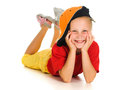 A cheerful little child with funny cap is lying Stock Photography