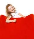 Cheerful little girl on armchair Royalty Free Stock Photo