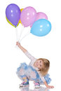Cheerful little girl with balloons a is playing on the white background Stock Image
