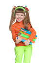 Cheerful little girl with books a portrait of a on the white background Royalty Free Stock Photography
