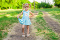 Cheerful little girl on a green grass Royalty Free Stock Photo