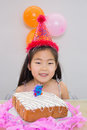 Cheerful little girl at her birthday party closeup portrait of a Stock Photos