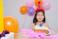 Cheerful little girl at her birthday party closeup portrait of a Stock Photo