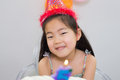 Cheerful little girl at her birthday party closeup portrait of a Royalty Free Stock Photo