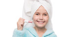 Cheerful little girl with hygienic lipstick close up portrait of Stock Photography