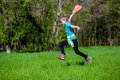 Cheerful little girl jump on the grass Royalty Free Stock Photo