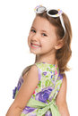 Cheerful little girl looks back Stock Photography