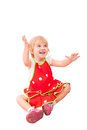 Cheerful little girl in red apron Stock Image