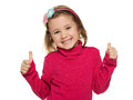 Cheerful little girl in red with her thumbs up Stock Images