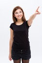 Cheerful lovely cute young woman looking and pointing away over white background Stock Photography