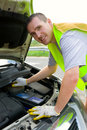Cheerful man mechanic and a car Stock Photography