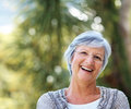 Cheerful mature female in the park - Outdoor Stock Images