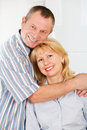 Cheerful mature man and woman smiling together portrait of men women Stock Photos