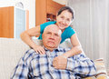 Cheerful mature woman with elderly husband portrait of women in home interior Stock Images