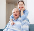 Cheerful mature woman with husband women senior in home interior Stock Image