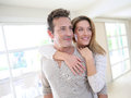 Cheerful middle aged couple embracing each other at home Royalty Free Stock Photos