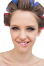 Cheerful model with hair curlers looking at camera Royalty Free Stock Photography