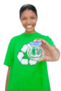 Cheerful model wearing recycling tshirt holding pot on white background Stock Images