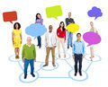 Cheerful multi ethnic group of people standing individually in a circle which connects to others with empty colored speech Stock Photos