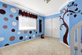 Cheerful murals in baby room beautiful interior with on bright blue walls Royalty Free Stock Image