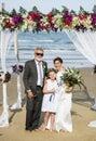 Cheerful newlyweds at beach wedding ceremony Royalty Free Stock Photo