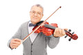 Cheerful old man playing a violin isolated on white background Stock Photos