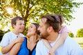 Cheerful parents spending weekend with children
