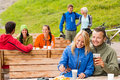 Cheerful people enjoying springtime weekend rest area drinking beer Stock Image