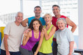 Cheerful people in sportswear at fitness gym portrait of Royalty Free Stock Photography