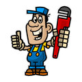 Cheerful plumber holding pipe wrench Royalty Free Stock Photo
