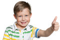 Cheerful preschool boy a portrait of a with his thumb up on the white background Royalty Free Stock Photo