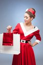 Cheerful retro girl holding shopping bags Stock Photos